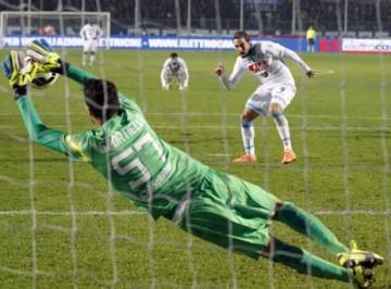 Atalanta goalkeeper Marco Sportiello saves a penalty kicked by Napoli's Gonzalo Higuain during a Serie A soccer match in Bergamo, Italy, Wednesday, Oct. 29, 2014. (AP Photo/Felice Calabro')